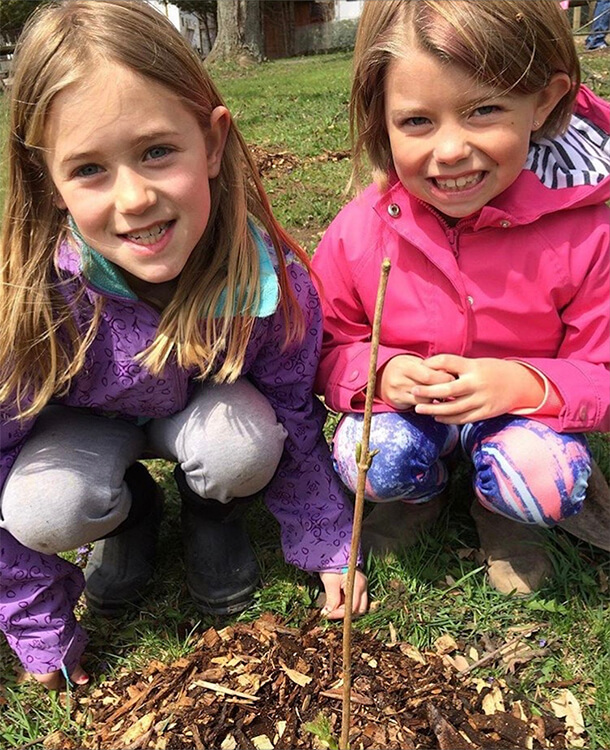 Kids at Wildwood planting trees with Jessika Guy of The Green Hair Spa